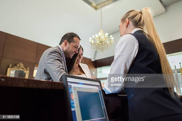 Business people checking in at a hotel