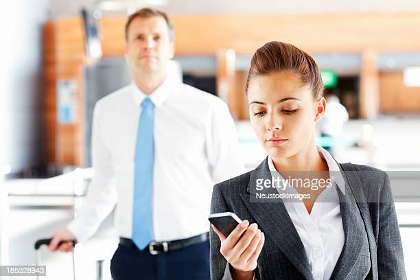 Business People Checking In At Airport