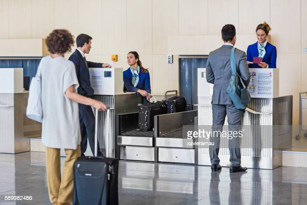 Business people checking in at the airport