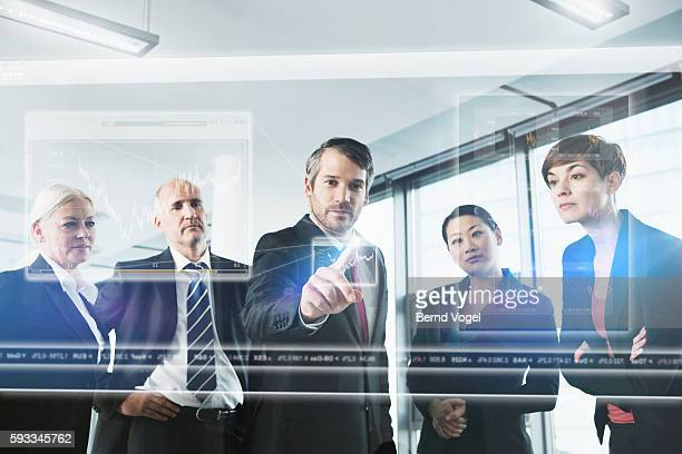 Business people checking stock-exchange prices