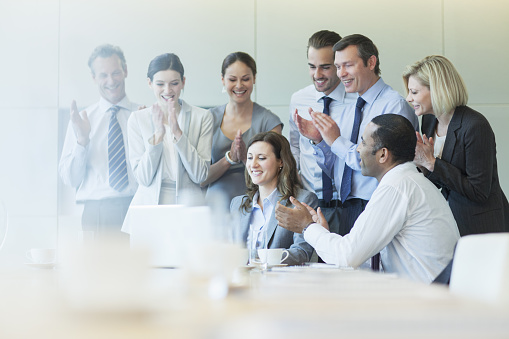 Business people cheering in meeting - gettyimageskorea