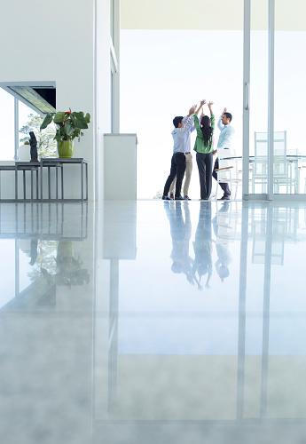 Business people cheering in office - gettyimageskorea