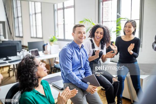 business people clapping for male colleague in office - applauding stock pictures, royalty-free photos & images