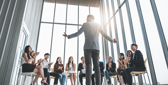 Business people clapping hands during meeting in office for their success in business work 1049824998