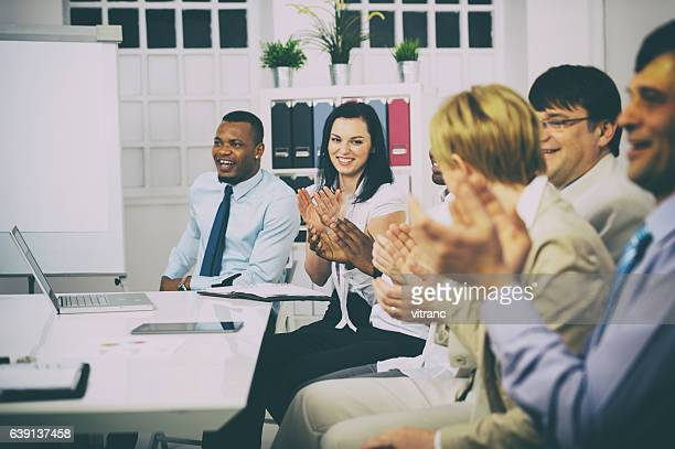 business people clapping hands - summit meeting stock pictures, royalty-free photos & images