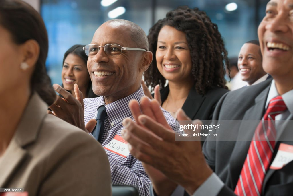 Business people clapping in presentation in office : Stock Photo