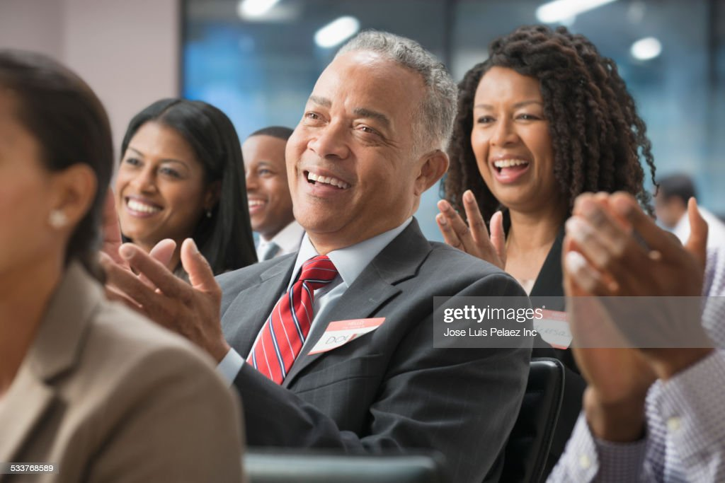 Business people clapping in presentation in office : Foto stock