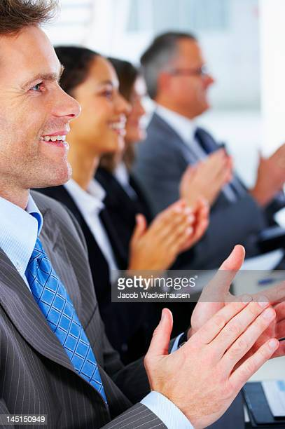 Business people clapping in the conference room