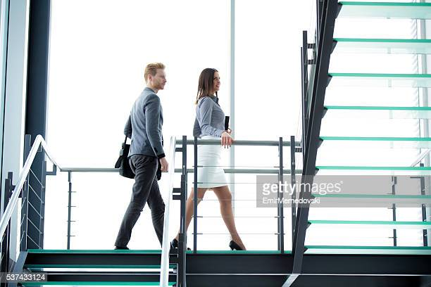 Business people climbing a stairway.