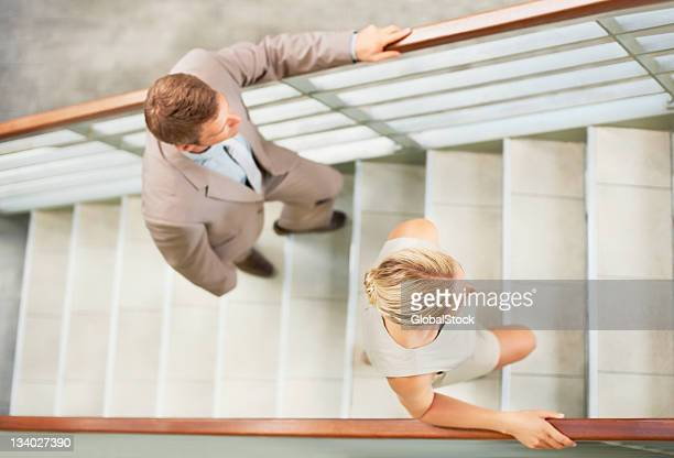 Business people climbing steps