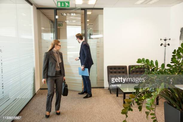 business people comming to a meeting - closing stock pictures, royalty-free photos & images