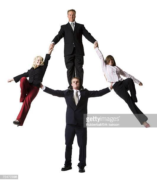 Business people creating a human pyramid
