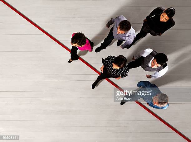 Business people crossing a red line