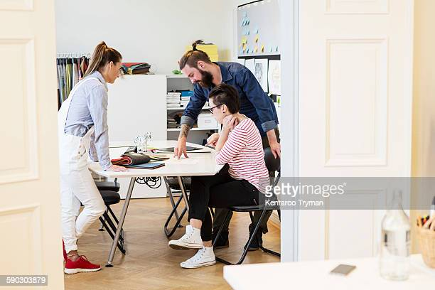 business people discussing at desk in creative office - design occupation stock pictures, royalty-free photos & images