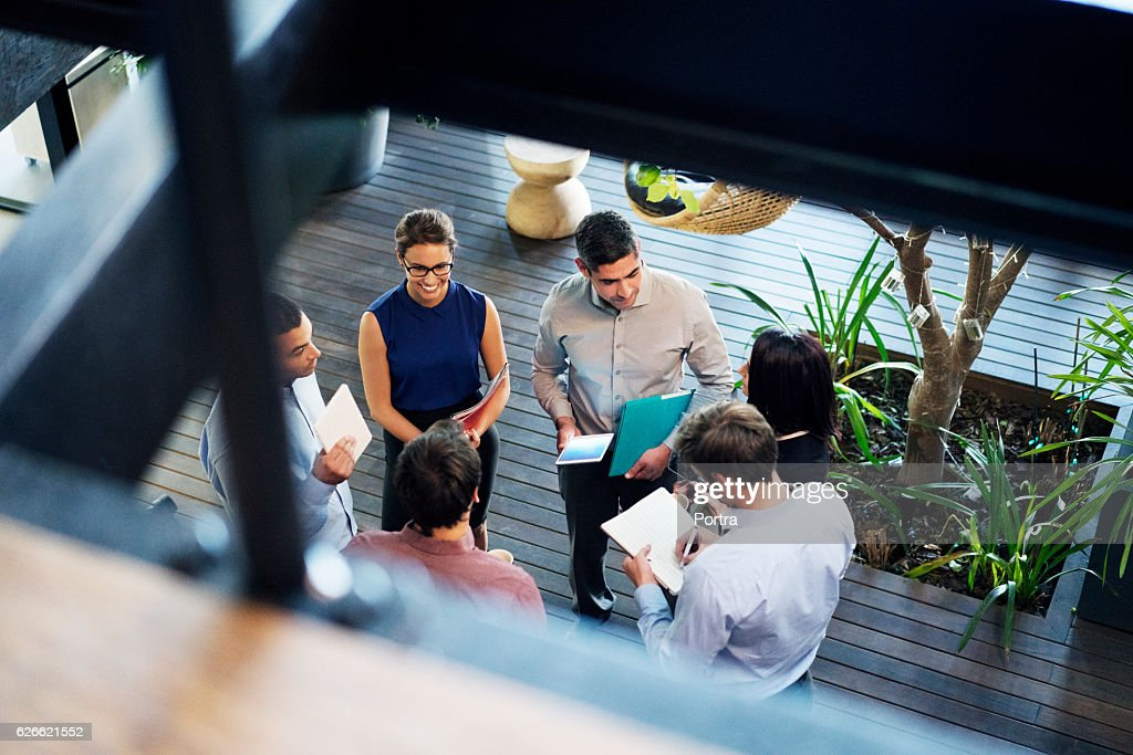 Business people discussing at lobby : Stock Photo