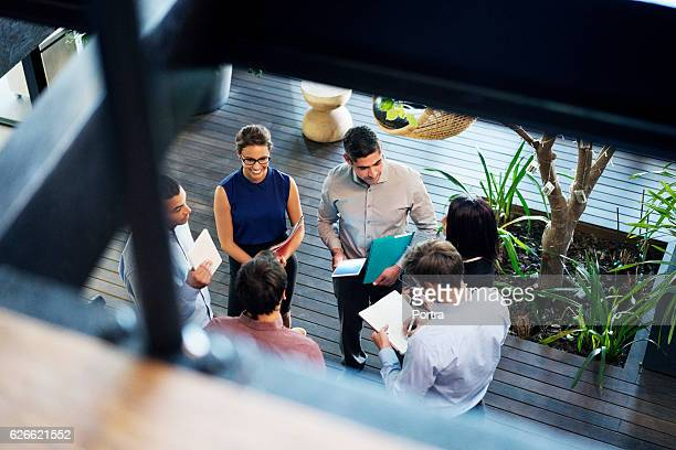 business people discussing at lobby - a team stock photos and pictures