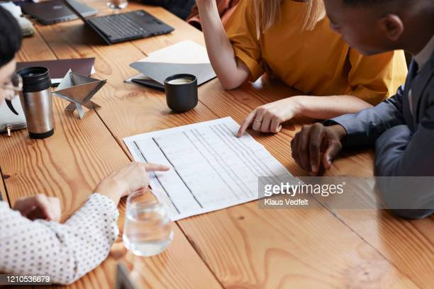 business people discussing at table in office - human body part stock pictures, royalty-free photos & images