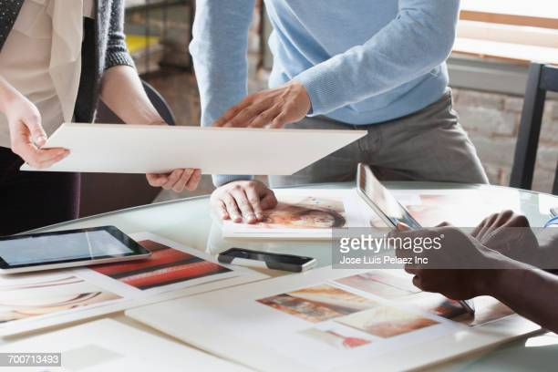 Business people discussing design in office