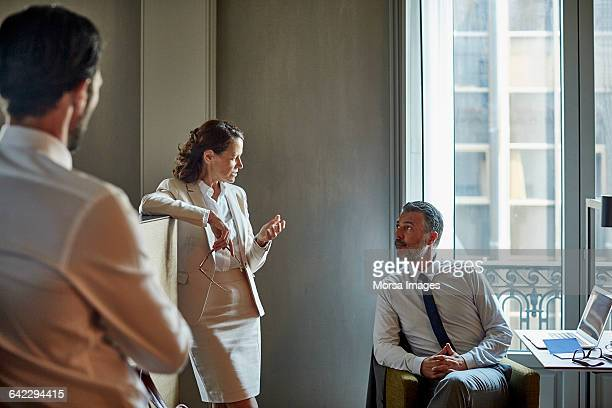 Business people discussing during meeting at hotel