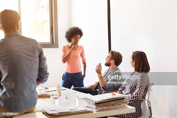 Business people discussing in board room