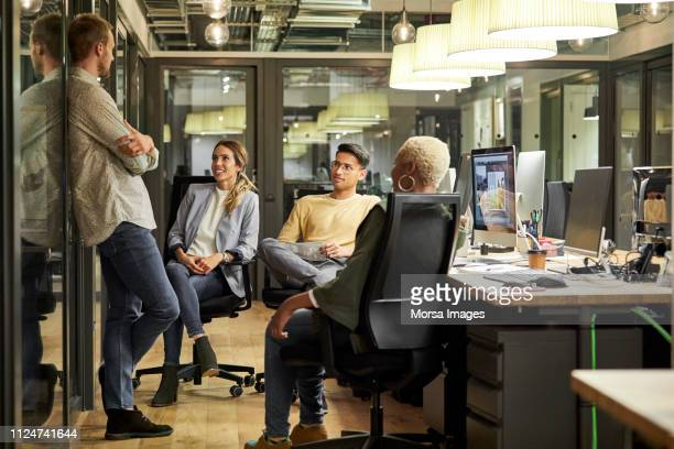 business people discussing in creative office - cultures stock pictures, royalty-free photos & images
