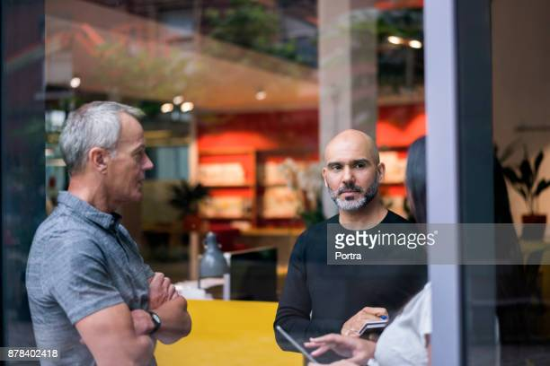 business people discussing in creative office - business casual stock pictures, royalty-free photos & images