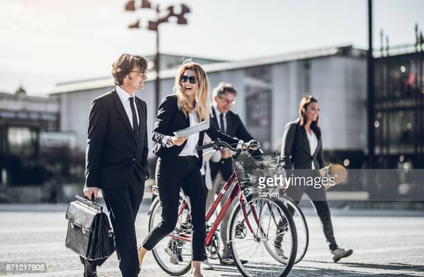 business people discussing in front of building - financial district stock pictures, royalty-free photos & images