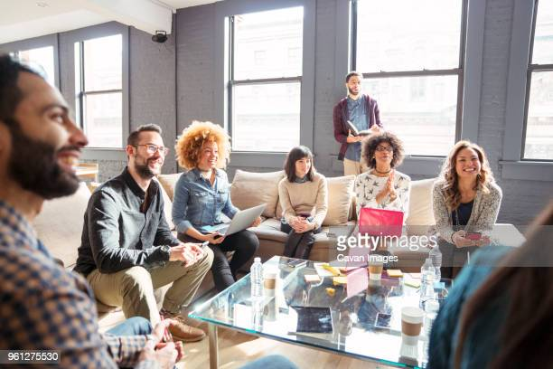 business people discussing in room at office - mid adult men stock pictures, royalty-free photos & images