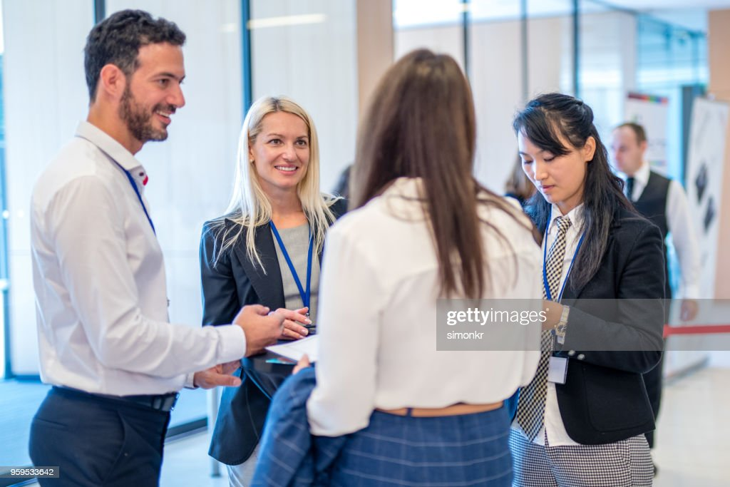 Business people discussing in seminar at auditorium : Stock Photo