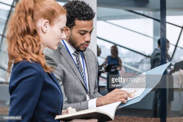 business people discussing in the board room - formal stock pictures, royalty-free photos & images