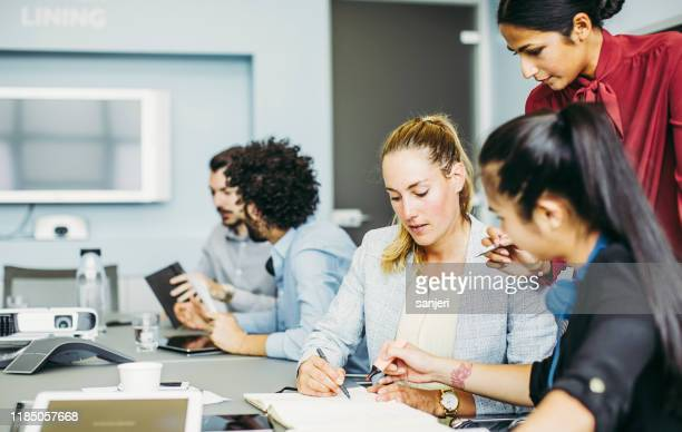 business people discussing in the board room - staff meeting stock pictures, royalty-free photos & images
