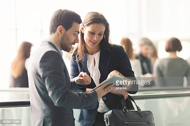 Business people discussing in the lobby