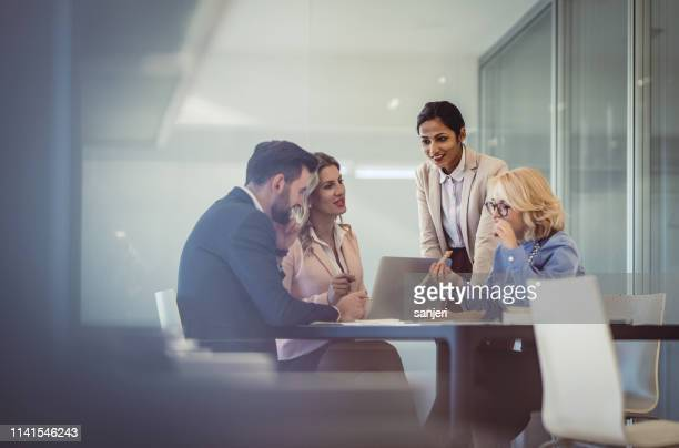 business people discussing in the office - business finance and industry stock pictures, royalty-free photos & images