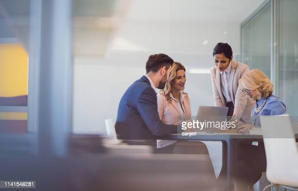 business people discussing in the office - financial advisor stock pictures, royalty-free photos & images