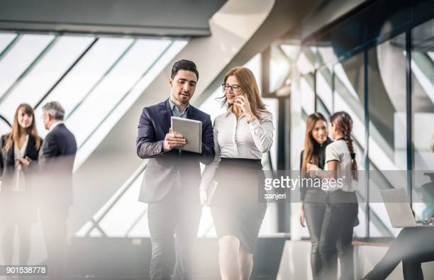business people discussing in the office - bank stock pictures, royalty-free photos & images