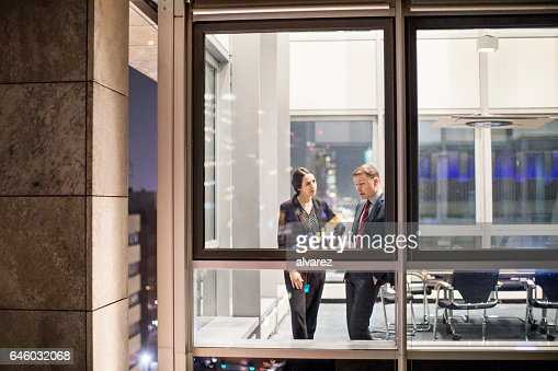 Business people discussing inside modern office