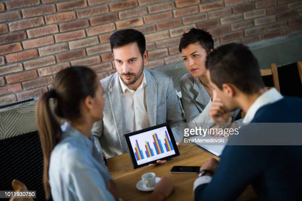Business people discussing new business approach during business meeting