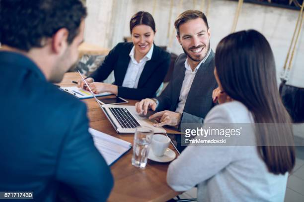 Business people discussing new business strategy during business meeting
