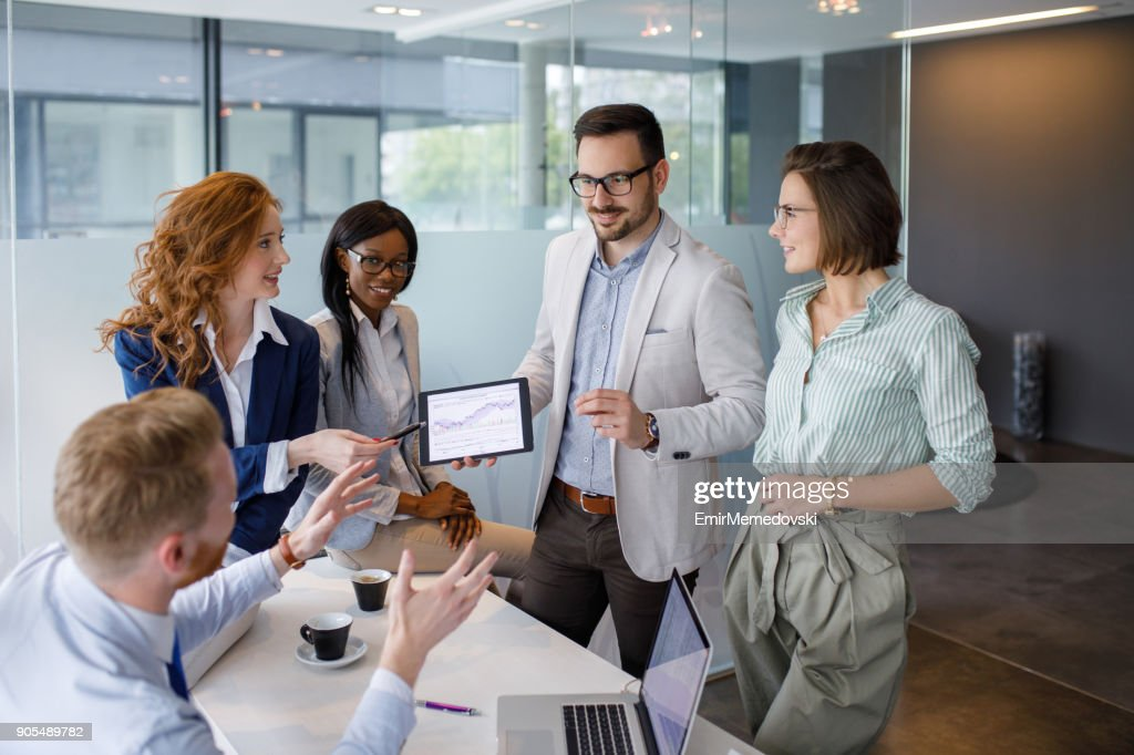 Business people discussing new market and sales analysis : Stock Photo