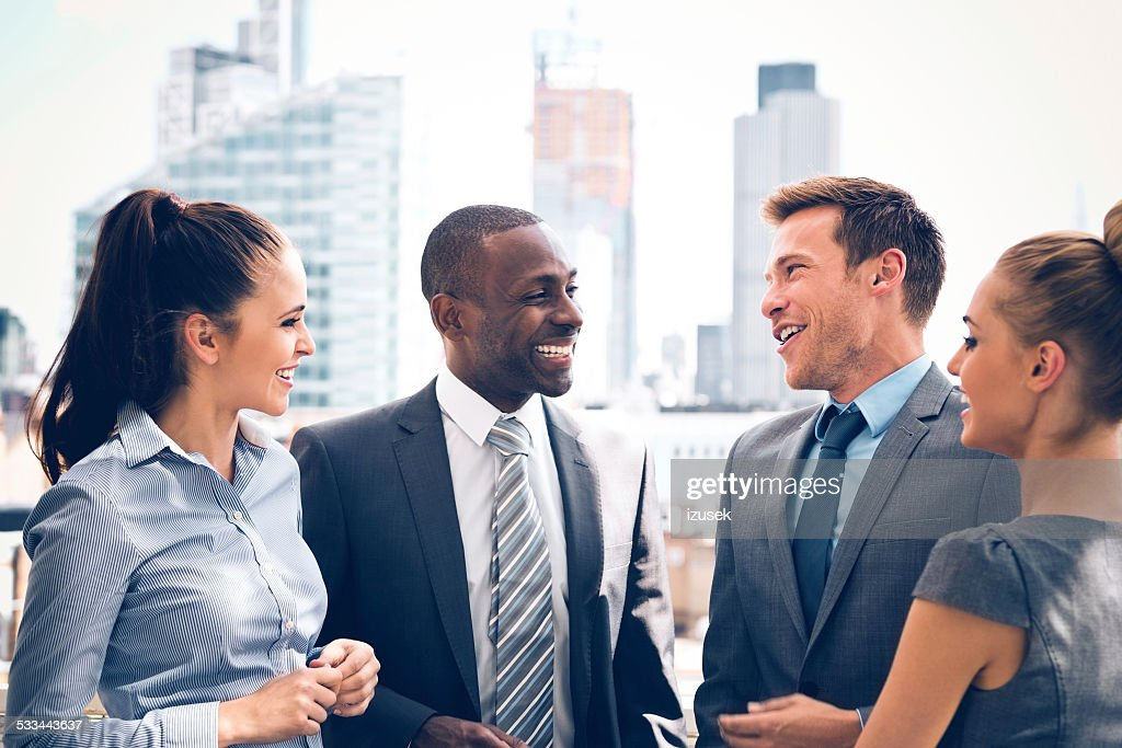 Business people discussing outdoor : Stock Photo