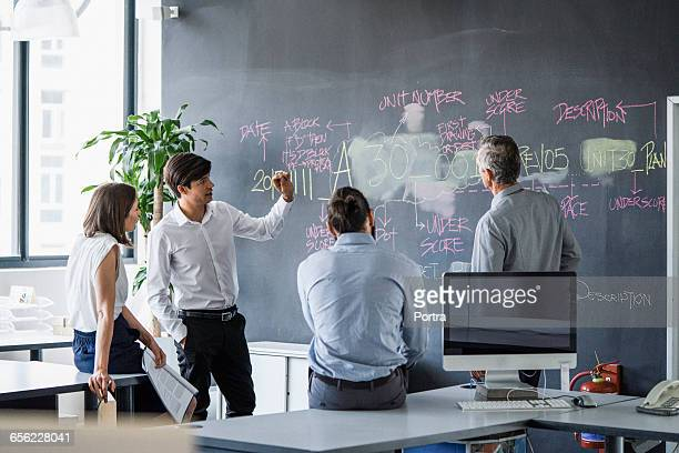 Business people discussing plan in office