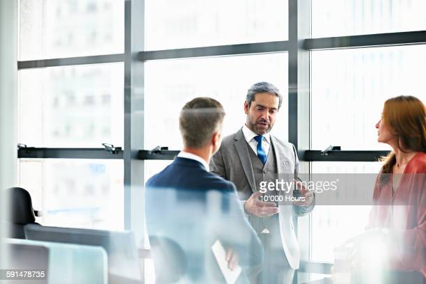 business people discussing plans in modern office - employee engagement stock pictures, royalty-free photos & images