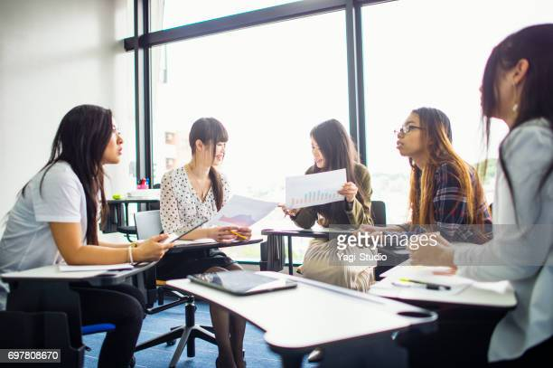 Business people discussing project in conference room