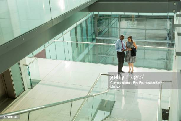 business people discussing project in office - building atrium stock pictures, royalty-free photos & images