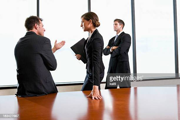 Business people discussing strategy in boardroom