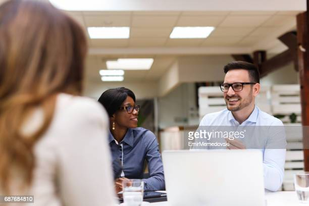 business people discussing strategy with a financial analyst - financial analyst stock photos and pictures
