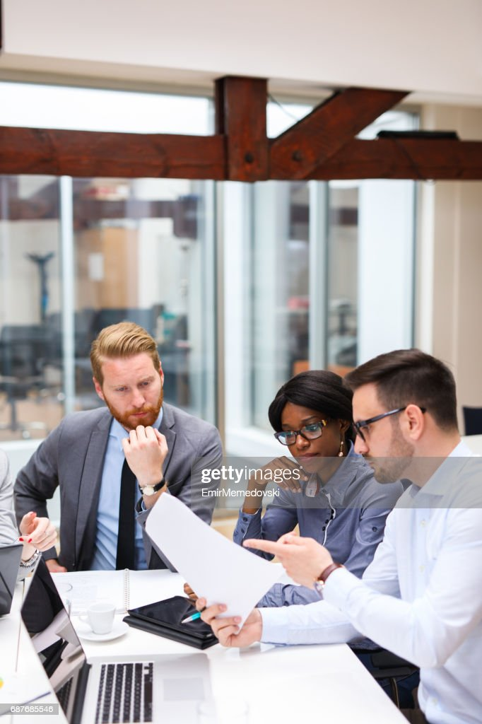 Business people discussing strategy with a financial analyst : Stock Photo