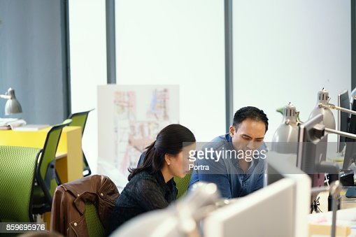 Business people discussing while sitting in office