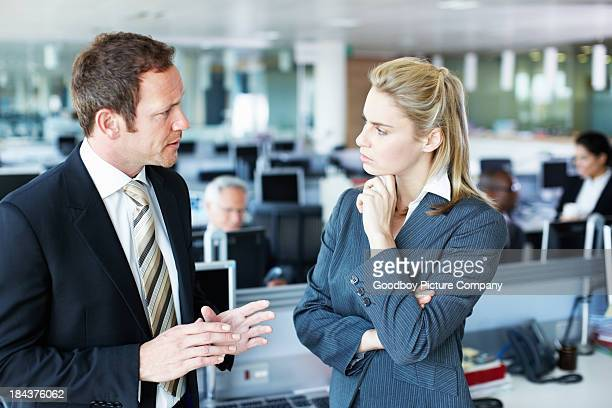 Business people discussing with each other