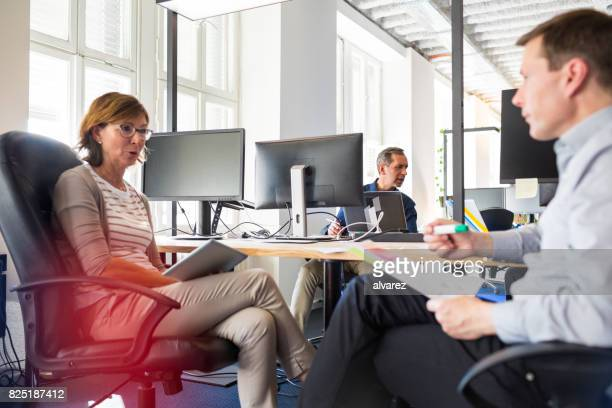 Business people discussing work at startup office